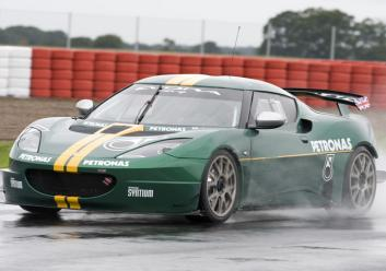 Evora GT4 Fr3Qtr action wet test